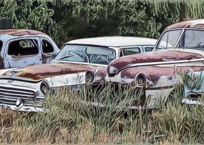 several old cars parked in a field and forgotten