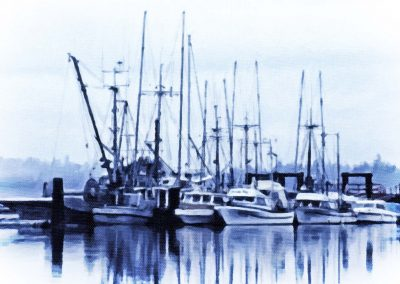 Several boats moored at the wharf