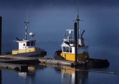 Two tugboats tied up to the wharf