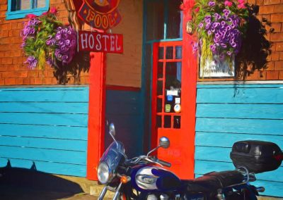 a motorcycle in front of the Fool Hostel in Cumberland, BC Canada
