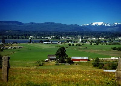 Comox Valley farmland, mountains, and glacier