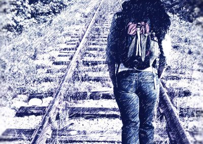 girl walking on railroad tracks