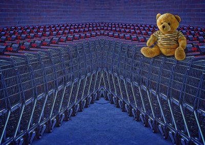 an abstract of a teddy bear and shopping carts